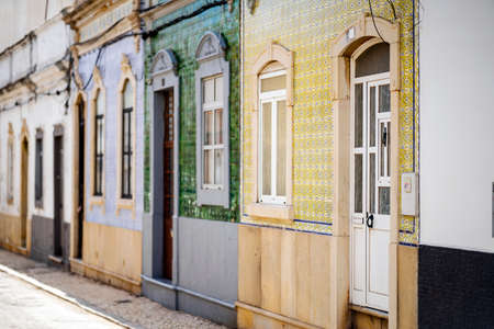 Beautiful houses cover with traditional tiles called azulejo, Olhao, Algarve, Portugal