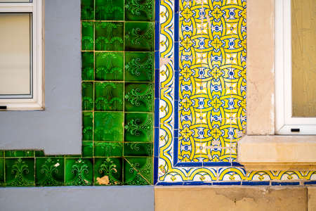 Close up of typical tiles on the facades of old houses in Olhao, Algarve, Portugal