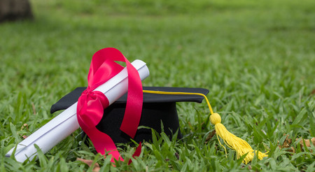 graduate hat and certificated in the garden