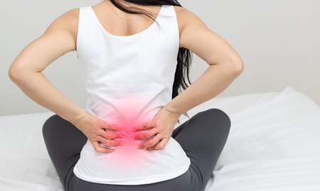 women Back pain after wake up in morning Stockfoto