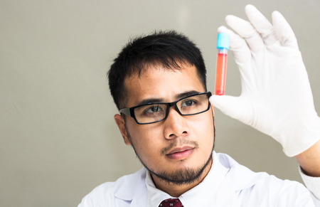Scientists experiment with red compounds.