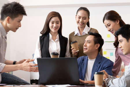 Asian business man and women meeting and talk about job in office. 版權商用圖片