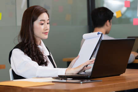 Business asian woman happy working job on laptop in office.