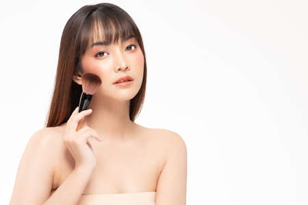Beauty asian woman hold make up brush  and cheerful with make up brush
