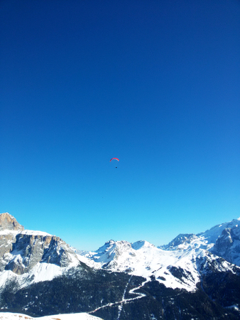 Paragliding in the Alps against the sky