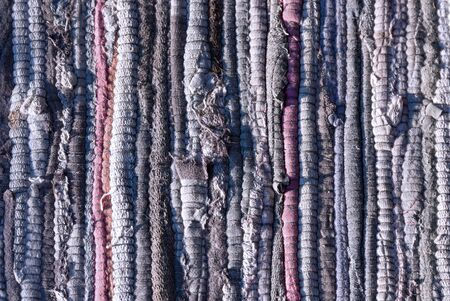 rough knitted fabric rug texture as rustic background