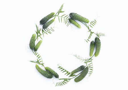 Wreath made of cucumbers on a white background