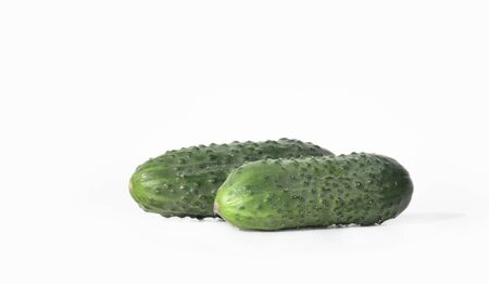 Two fresh cucumbers were shot close-up on a white background