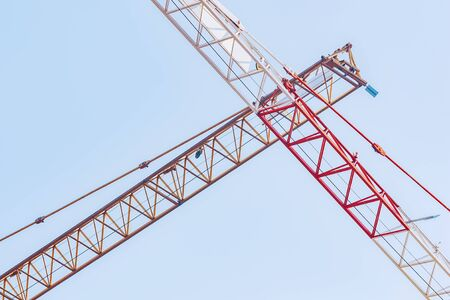 The boom of a construction crane on sky background