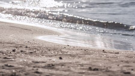 Water and sand in sunlight as a blurred background Stock Photo - 137045271