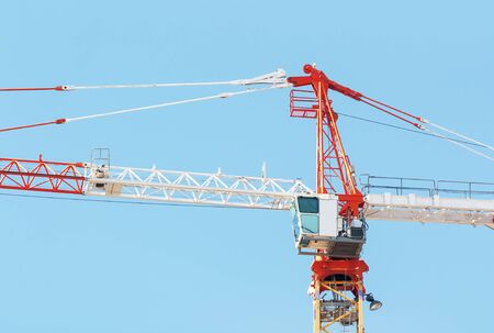 Part of construction crane with cabin on sky background