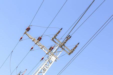 Close-up of a power line against the blue sky Standard-Bild