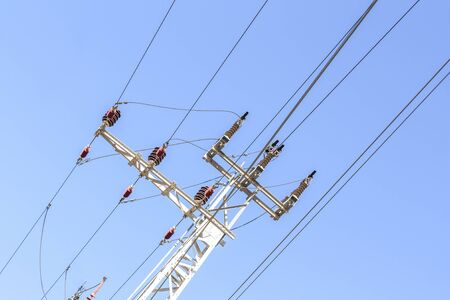 Close-up of a power line against the blue sky