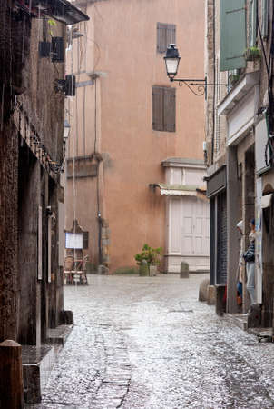 Torrential rain on the street of an ancient tourist city Zdjęcie Seryjne