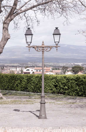 Vintage lamppost on the background of a European hilly landscape