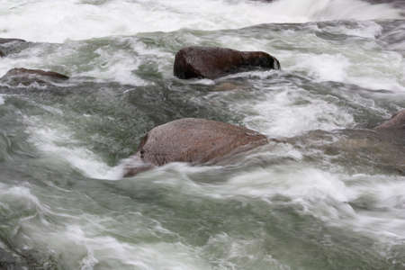 Plasticity of movement of water of the mountain river among the stones