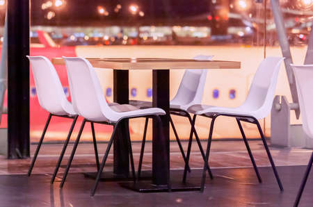 Cafe zone at the airport at night as a concept of life in constant flights