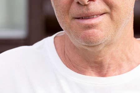 The chin of an unshaven smiling man Reklamní fotografie