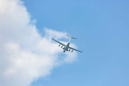 Turboprop aircraft flying through the sky at low altitude