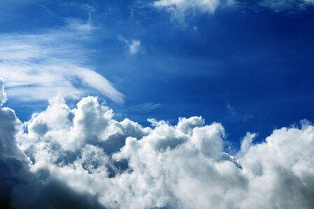 ozone layer: Hazy blue summer sky background with wisps of fine cirrus clouds in an empty expanse of cerulean blue for a fresh tranquil nature abstract. Stock Photo
