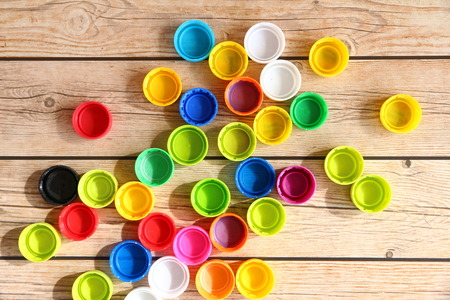 Bottle Caps of Colorful on wooden background