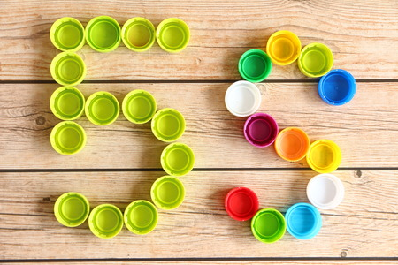 5s: 5S Bottle Caps of Colorful on wooden background