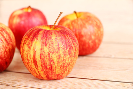 genetic food modification: Honeycrisp apples with a wood background.
