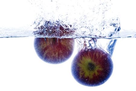drop in: Splashing Apple drop in water Stock Photo