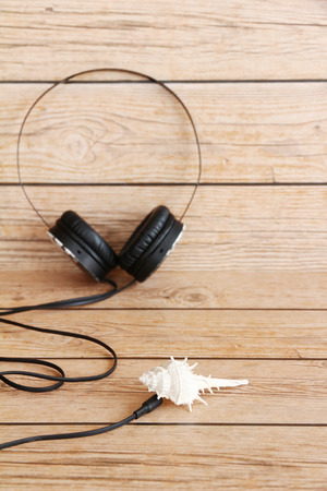 personal accessory: Headphone on wooden background. Stock Photo