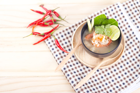 sour grass: The hot and famous Tom Yum Khung nature of Thailand on wooden background.