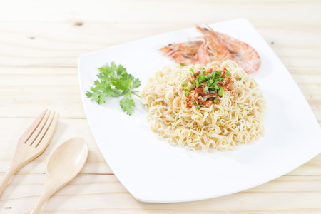 the instant noodles: Instant noodles food in white on wooden background. Stock Photo