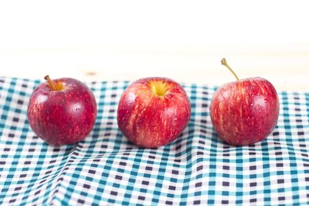 three objects: Red apples on a wood table from my idea.