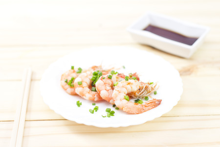 prepared shellfish: Colorful Steaming Shrimpon wooden background. Stock Photo
