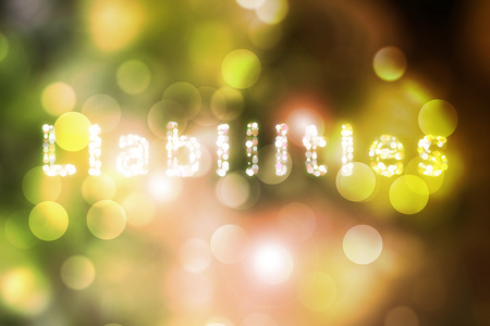 liabilities: Text Liabilities Yellow bokeh blurred beautiful from my idea. Stock Photo