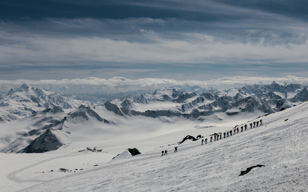 elbrus: Group of mountaineers climbing at the slope of mount Elbrus, Caucasus.
