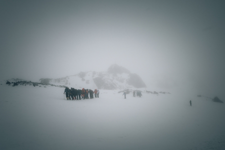 achievment: Group of mountaineers climbing at the slope of mount Elbrus, Caucasus.