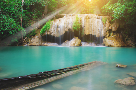 Beautiful waterfall in tropical forest with clear water at Erawan National Park in Kanchanaburi, Thailand. Stock Photo