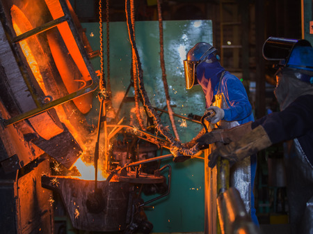 metallurgist: matallurgic production, production of cast iron, metal melting Stock Photo
