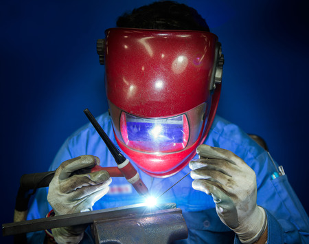 Welding work with worker by hand photo