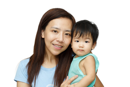 single parents: Asian mother smiling with her daughter