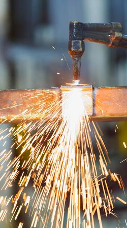 worker adjest acetylene torch photo