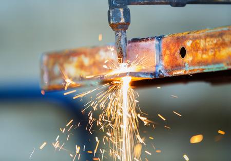 worker adjest acetylene torch