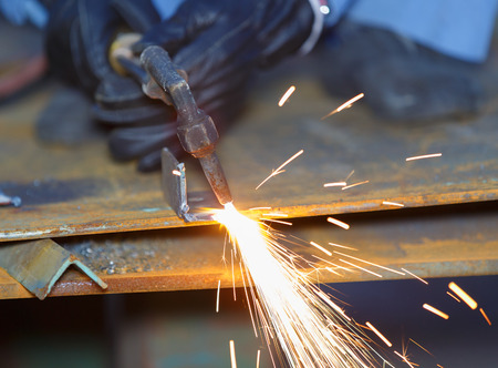 acetylene: worker use acetylene torch to cutting metal