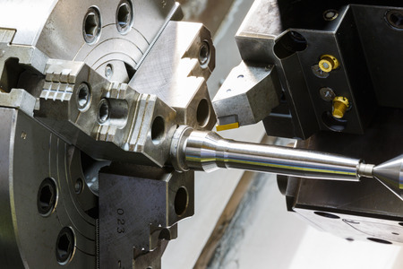 lathe: industrial metal work machining process by cutting tool on  CNC lathe