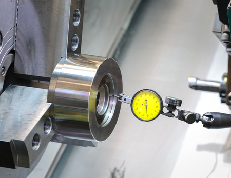 automated tooling: industrial metal work machining process by cutting tool on CNC lathe Stock Photo