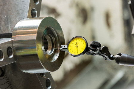 affixment: industrial metal work machining process by cutting tool on CNC lathe Stock Photo