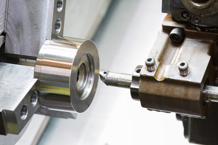 cutting tool: industrial metal work machining process by cutting tool on CNC lathe Stock Photo