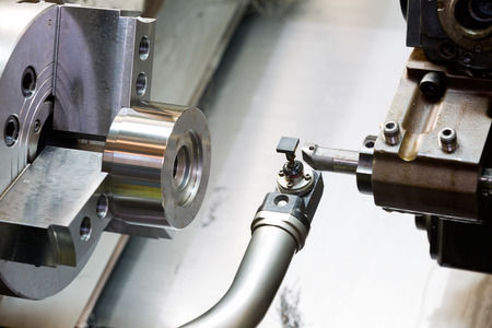 industrial metal work machining process by cutting tool on CNC lathe Stock Photo