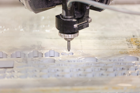 cutting: waterjet metal cutting by cnc programing Stock Photo