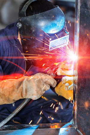 worker welding construction by MIG welding 스톡 콘텐츠